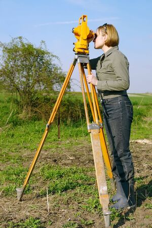 geodetic: Female geodesist performing geodetic survey using altometer