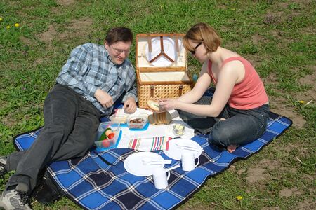 Young couple having picnic in the park photo