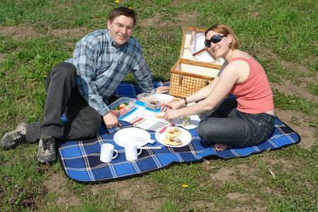 vegetables young couple: Young couple having picnic in the park Stock Photo