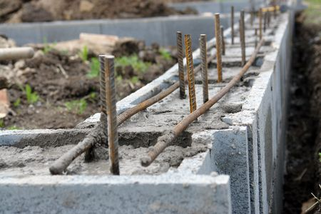 hollow wall: Closeup of house foundation made from concrete shuttering blocks filled with mortar and reinforcement bars