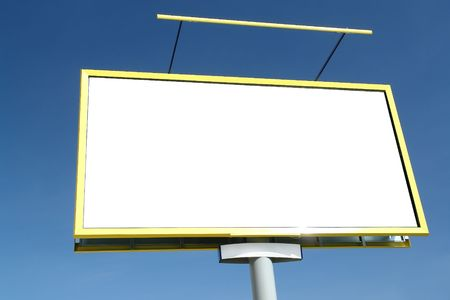 Closeup of large blank billboard waiting for advertisement to be added - against clear blue sky photo