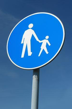 walking zone: Child pedestrian roadsign over blue sky