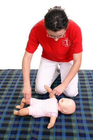 reanimation:  first aid series - First aid instructor showing how to check pulse on  dummy Stock Photo