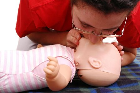 reanimation:  dummy first aid demonstration series - first aid instructor demonstrating artificial respiration using  dummy