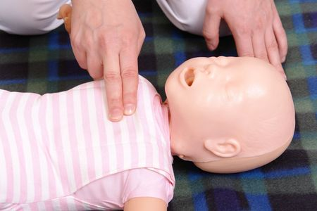 reanimation:  dummy first aid demonstration series - first aid instructor demonstrating how to check  life functions