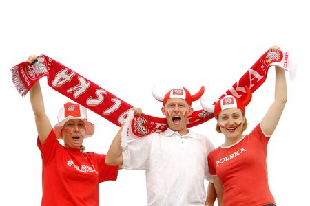 Three young Polish soccer fans dressed in Polish national color t-shirts, caps and scarfs cheering on over white background