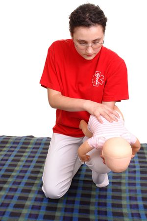 choking: First aid demonstration series - first aid instructor demonstrating on  dummy how to rescue the  from suffocation Stock Photo