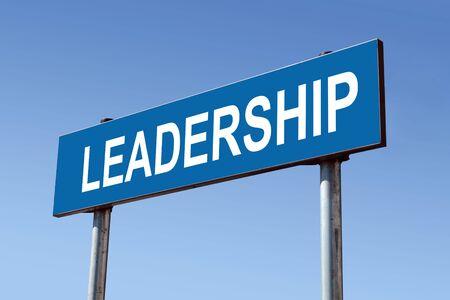 Metal roadsign spelling Leadership word over blue sky photo