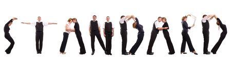 Group of young business people standing over white forming STANDARD word Zdjęcie Seryjne