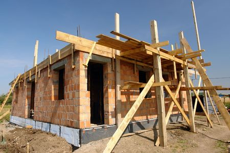 Single-family brick house under construction photo