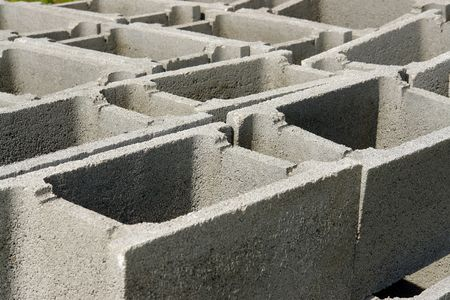 Closeup of concrete shuttering blocks stacked on construction site