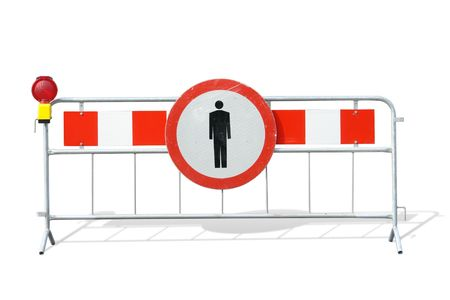 Metal red and white striped road construction barrier with no access sign and red beacon over white background photo