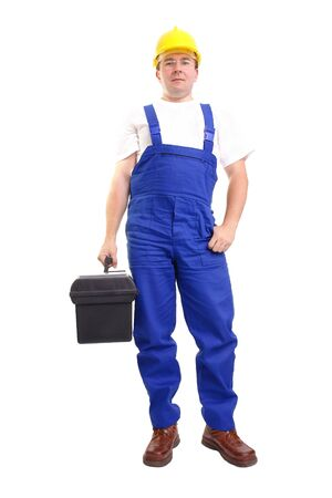 Service man wearing blue helmet and overall holding black toolbox over white photo