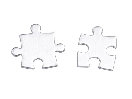 Two silver matching puzzle pieces over white background