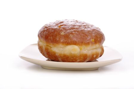 doughnut: Polish donut on plate isolated on white