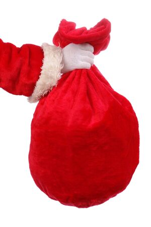 sackful: Santa Claus hand holding red sack full of presents over white background