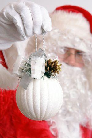 Closeup of Santa Claus holding white christmas ball Stock Photo - 3929410