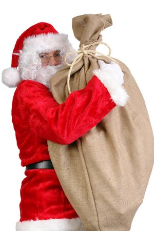 sackful: Santa Claus holding big sack full of christmas presents over white Stock Photo