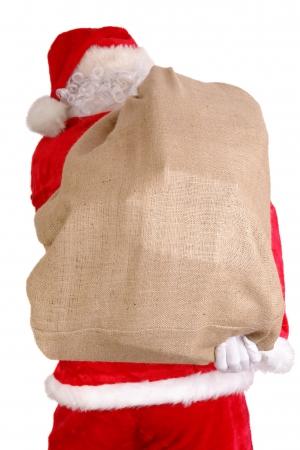 sackful: Santa Claus carrying big sack on his back full of christmas presents
