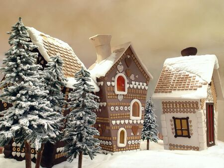 Little snow covered cottages made from gingerbread photo