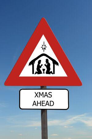 Xmas Ahead warning roadsign over blue sky photo