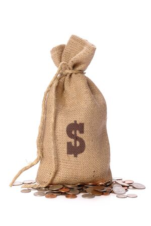 Jute bag with dollar sign stamp filled with American dollar coins over white background photo
