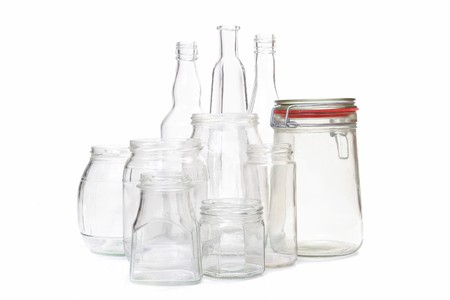 Clear glass jars and bottles over white background