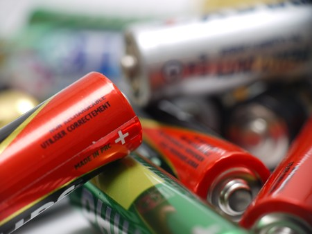 Closeup of pile of used alkaline batteries