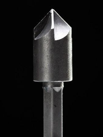 wood cutter: Closeup of wood shaper cutter head shot over black background