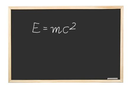 mc2: Famous Albert Einsteins equation E=mc2 handwritten on blackboard Stock Photo