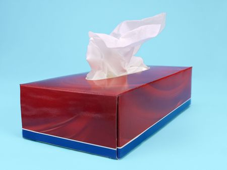Paper tissue box over light blue background Stock Photo