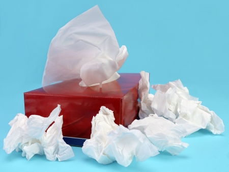 soft tissue: Paper tissue box with used tissues over light blue background Stock Photo