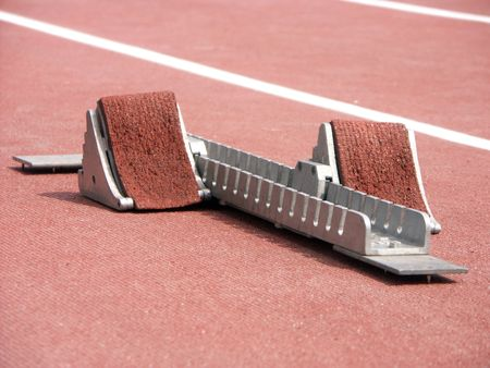 jogging track: Shot of starting blocks on racing track Stock Photo