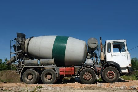 concrete mixer truck: Concrete mixer truck parked at construction site Stock Photo