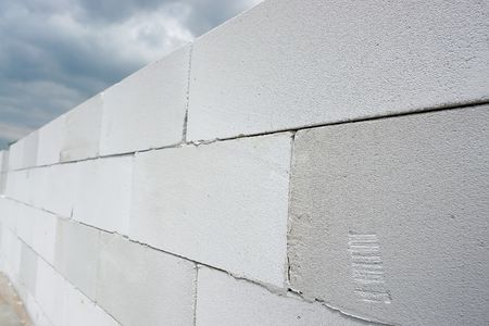 concrete blocks: Unfinished house wall made from white aerated autoclaved concrete blocks
