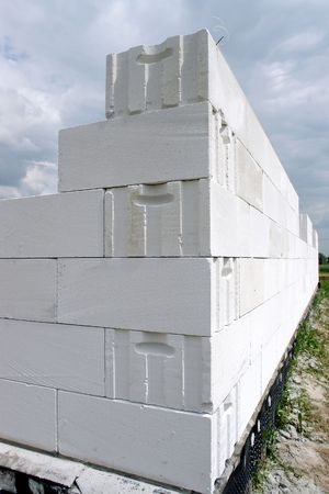 Unfinished house wall made from white aerated autoclaved concrete blocks