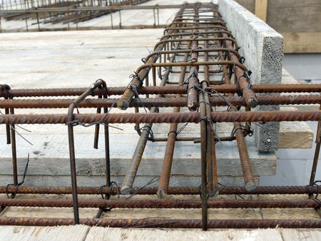 Closeup shot of steel bar reinforcement used for reinforcing concrete slab photo