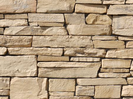 Closeup shot of house wall made from beige slate rocks Stock Photo