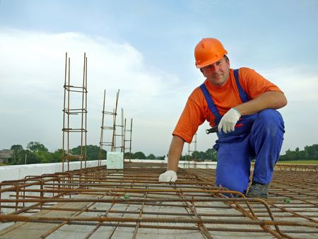 Portrait of bar bender on slab steel reinforcement Stock Photo - 5190175