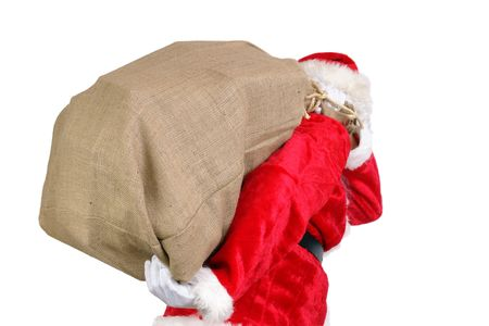 Santa Claus carrying big sack on his back full of christmas presents