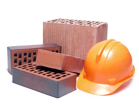 Solid and perforated bricks and orange hard hat isolated on white Stock Photo - 5285656