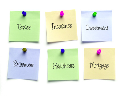 obligations: Six post-it notes as a reminder of taxes, insurance, investment,retirement,healthcare and mortgage obligations