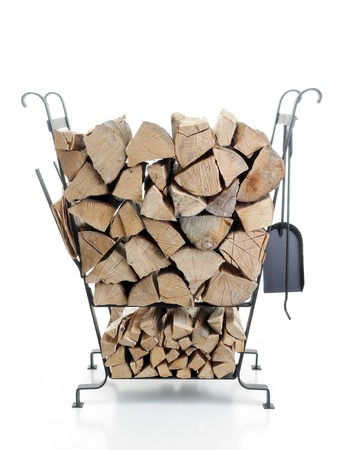 Black firewood metal stand loaded with chopped beechwood logs shot on white background