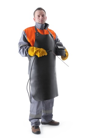 Portrait of welder wearing protective welding black leather apron, welding hood and welding electrode holder over white photo