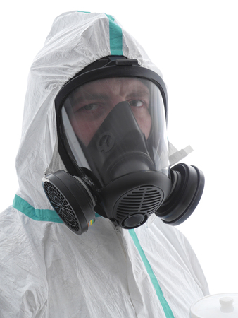 Closeup of spray painter wearing white coverall and respirator shot over white background photo