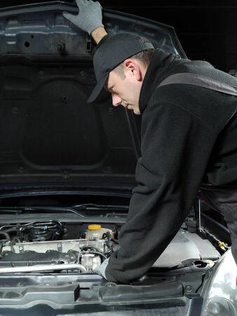 mechanic repairing a car Stock Photo