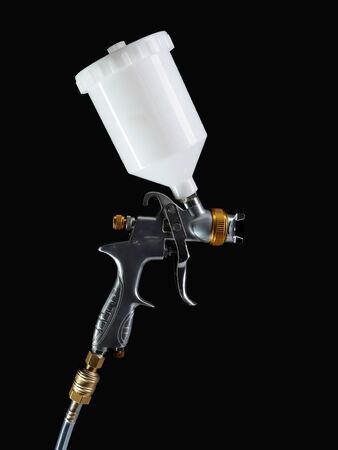 refurbish: Spray gun shot over black