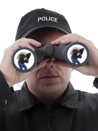 Policeman spotting masked burglar carrying bag with stolen things, through binocular, conceptual shot on white photo