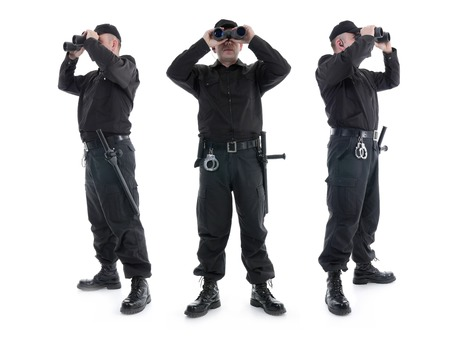 Three security guards wearing black uniform looking through binoculars, in three different directions, shot on white photo