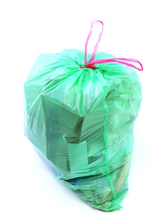 Green plastic bag full of domestic garbage shot on white background Stock Photo